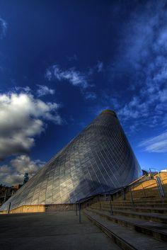Train passes the Museum of Glass, Tacoma, Washington by Justin Kraemer.