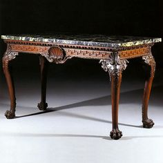 A George II Marble Top  Mahogany Console Table (1755)