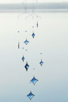Floating stars? Water drops? This glass mobile can be whatever you see.