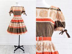 Vintage 1950s Tribal Novelty Print Dress / 50s by NosillaVintage, $148.00