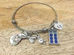 The 11th Doctor inspired bangle bracelet. by ColorfulGeekiness