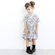 The Phoenix and The Fox Memphis Dress in Harajuku Leopard design is 100% certified organic cotton.  Made from super soft stretch fabric that moves with child for extra comfort.  Dress has scoop hemline at back.  Designed in Australia