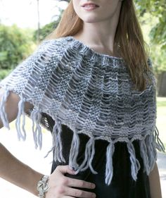 Free Knitting Pattern for Drop Stitch Cowl - Shoulder cozy knit in garter stitch with dropped stitches and fringe. Quick knit in super bulky yarn. Great with variegated yarn. Designed by Vanessa Ewing