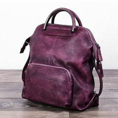 Genuine Leather Hand Bag Women Backpack Casual Backpack We use genuine cow leather, quality hardware and fabric to make the bag as good as it is. •Comfortable Shoulder Strap. • Inside zipper pocket, cell phone pocket •Ancient black gold hardware •Length: 26cm; Height: 28cm;Width: 15cm •Color:Brown/Purple/Grey