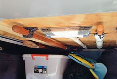 Mount cleaning supplies and other long items to the ceiling with brackets. | 44 Brilliant Space-Saving Storage Solutions For Your RV/Camper