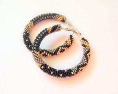 Beaded hoop earrings in black grey and gold Beadwork by lutita