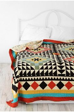 college dorm here I come... i would LOVE a quilt bed cover.