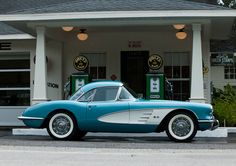 1950's corvette looks so elegant and the baby blue is so complimentary to it's loose design