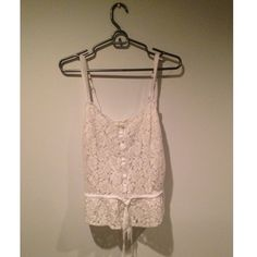 Hollister white lace tank top White lace tank top, great for layering with a draw string to make waist tighter. Make an offer  Hollister Tops Tank Tops
