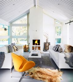 Swan chair prominent in this Swedish living room