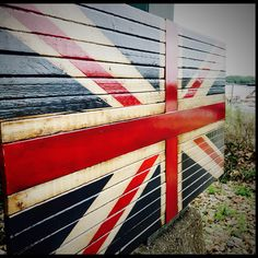 Really excited about our newest listing. A British Union Jack flag!!  Made of 35 pieces of wood. I constructed it of 4 panels that were glued and pressed to the solid pieces of wood that make up the Red cross in the center.  Very well made and sturdy!