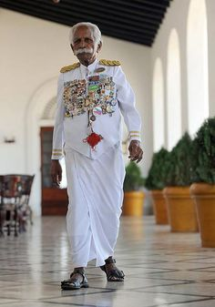 """The world's oldest, still working hotel doorman, """"Kuttan""""   Chattu Kuttan, is 91 years old and has been a doorman at the Galle Face Hotel for more than 70 years."""