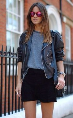Black skirt, grey t-shirt, black leather jacket, sunglasses