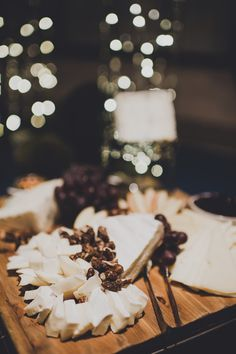 Chef's Selection of Artisan Cheeses: from Mt. Townsend Creamery, Rogue Creamery, & Cypress Grove, served with grape clusters, sliced apples & pears, fruit gelees, candied nuts, gluten-free crackers. Ravishing Radish Catering. Carina Skrobecki Photography.