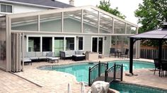 Pool Enclosure retracts over the house and out of the way. Just push the button and the whole enclosure moves providing full access to the pool. Watch more at: