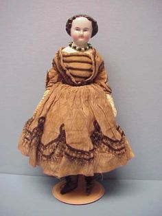 """""""1860's china head doll with original clothing."""""""