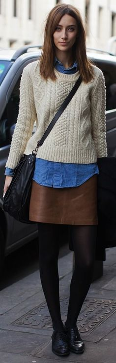 Shop this look on Lookastic: http://lookastic.com/women/looks/oxford-shoes-tights-mini-skirt-crossbody-bag-denim-shirt-cable-sweater/6667 — Black Leather Oxford Shoes — Black Wool Tights — Brown Leather Mini Skirt — Black Leather Crossbody Bag — Blue Denim Shirt — Beige Cable Sweater