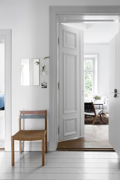 white and grey hall in a Swedish space. Entrance.