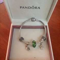 AUTHENTIC NEVER WORNPandora Bracelet w/ CHARMS Comes with 5 charms worth at least 100$ - a graduation cap, a rhinestoned cross and a green spacer bead as well as 2 silver spacers. WILLING TO NEGOTIATE. Great Christmas Gift Pandora Jewelry Bracelets