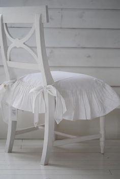 source:Butik Biskopsgården  ~ gorgeous chair withwhite card flounce cushion