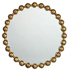Brighten Up Your Holiday Mantel. Enzo Mirror | Striking details give this wall mirror a modern feel. On an antique gold metal silhouette, round accents form a bead-like circular frame.