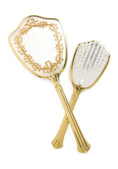 Before you're scheduled to sparkle, pencil in some time to prepare with this vintage brush-and-mirror set! You're enchanted by every precious floral detail that adorns each brushed silver back, their flared golden handles with glittering carved grooves, and the beveled border that surrounds your reflection. Whether the event is a birthday party or formal ball, the sight of this polished retro set will inspire a mood of regal radiance!    Period: circa 1970s