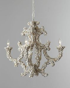 Ornate shell detail makes this chandelier unforgettable. Get it here: http://www.bhg.com/shop/arteriors-four-light-leeza-shell-chandelier-p50697fad82a71c80fe42d405.html