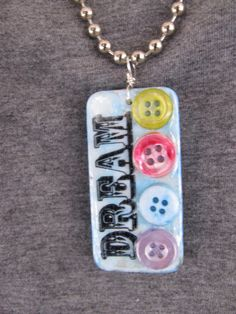 Altered Domino NecklaceAlcohol InksRubber by StitchesbyJulia via Etsy. Domino Crafts, Domino Art, Scrabble Art, Scrabble Tiles, Domino Jewelry, Craft Show Ideas, Game Pieces, Alcohol Inks, Corks