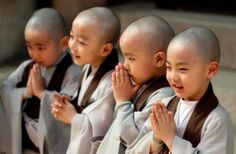 sweet faces of happy Buddhist children