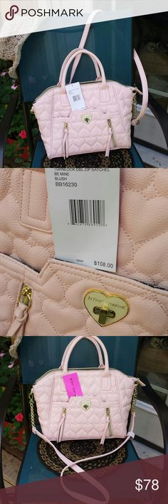 Betsy Johnson handbag Beautiful light pink purse, with gold hardware. This is a lg. Purse. It has a lg pocket on front with 2 zip pockets on each side. Has crossbody strap and handheld straps.1 lg. Zip and 2 slide pockets inside! 🌺🌺🌺🌺 true color shown in first photo. Betsey Johnson Bags Crossbody Bags