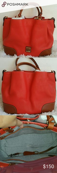 "Dooney & Bourke Pebble Leather Brenna Satchel with Dooney & Bourke Pebble Leather Brenna Satchel  DOES NOT COME WITH WALLET OR STRAP..ONLY  KEY FOB.COLOR BURNT  ORANGE.  IN GOOD CONDITION . HAS FLAWS. TAKEN PICTURES ABOVE.  Approximate measurements: Satchel 13""W x 10""H x 5-3/4""D with 5-1/2"" handles and a 23-1/2"" to 27-1/2"" strap drop, weighs 2 lb 8 oz; Pouch 7-1/4""W x 4""H x 1/4""D Body/trim 100% leather, lining 100% cotton Dooney & Bourke Bags Satchels"