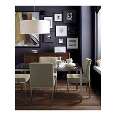 Love the dark walls with the light chairs and clear table.