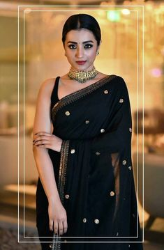 Can anything beat the beauty of a traditional half-saree ? Trendy Sarees, Stylish Sarees, Simple Sarees, Saree Blouse Patterns, Saree Blouse Designs, Black Blouse Designs, Dress Indian Style, Indian Dresses, Indian Wedding Outfits