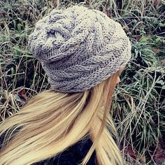 Cable Wrap Beanie by Katrine Hammer knitted sideways so the cables run horizontally around your head.  Yarn: Aran / 10 ply (8 wpi) Gauge: 17 st x 33 r = 4 inches Needle size: US 8 - 5.0 mm 164 - 175 yards (150 - 160 m)