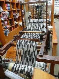 Hand loom loaded with space-dyed threads for Ikat weaving.  Photo by Luana Rubin