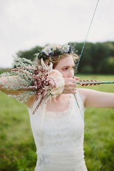 bride with a bow and arrow | Robin Hood inspired wedding | With Love & Embers Photography | Bridal Musings