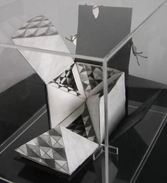 The Cube Book by Helen Malone. 2002. Book sculpture. Cube constructed of six pyramids opens out to reveal drawings and text, contained in a box with collapsible sides of Japanese paper. Calfskin vellum, pencil, ink, linen thread, Japanese paper, perspex box. 8 cm x 8 cm x 8 cm.
