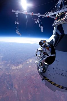 Felix Baumgardner dropping in front outer space, 70 miles up.