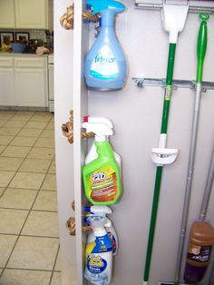 Cleaning Bottle Storage in the Pantry  I like this idea but would use something other than rope, like actual pulls so the rope isn't showing on the outside.