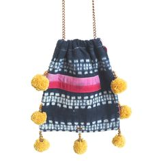 PATTAYA // GAIA pom pom bags are made from vintage + repurposed fabric by resettled refugee women living in Dallas //   www.gaiaforwomen.com