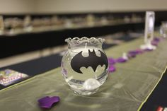 My wedding reception, hand painted batman centerpieces with floating pearls and candles