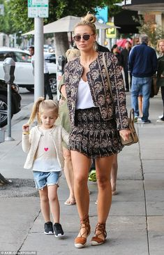 Like mother like daughter: Alex Gerrard showcased her tanned  pins as she enjoyed a stroll with four-year-old Lourdes inin Beverly Hills on Friday