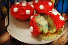 Smurf cupcakes - little mushroom cupcakes, that could work for a Smurfs party, or for a Mario themed party
