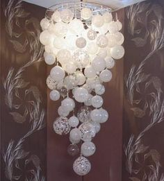 Bubble inspired light fixture. I wonder if this can be copied with balloons? For NYE, like champagne?