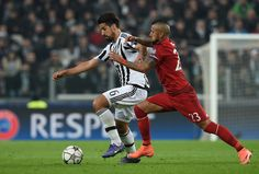 Sami Khedira of Juventus holds off the challenge from Arturo Vidal of Bayern Muenchen during the UEFA Champions League round of 16, first leg match between Juventus and FC Bayern Muenchen at Juventus Arena on February 23, 2016 in Turin, Italy. (Feb. 22, 2016 - Source: Matthias Hangst/Bongarts)