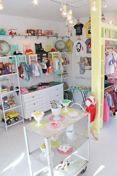 Shella Garcia recently opened a children's boutique for new and vintage clothing, toys and accessories in Long Beach, California. With a color palette akin to a bag of Jordan Almonds, there are some ideas here you could steal for your own child's room. Boutique Decor, Children's Boutique, Boutique Stores, Boutique Ideas, Kids Store Display, Store Displays, La Petite Boutique, Clothing Displays, Baby Shop