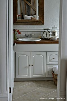 Love the tile floor, wooden Murrow and paint color, simply white by BM