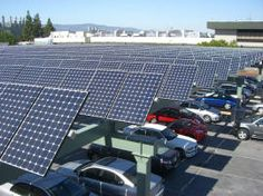 solar panel carports - brilliant! Capture the sun and keep the cars in the shade in hot climates