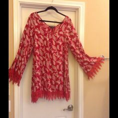 Bell sleeve Red dress / tunic / shirt Red dress / tunic / shirt with lace trim. This would look cute with boots or wrap sandals Tops Tunics
