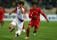 Reza Ghoochannejhad of Iran with Korea Republic in action during the FIFA 2014 World Cup...